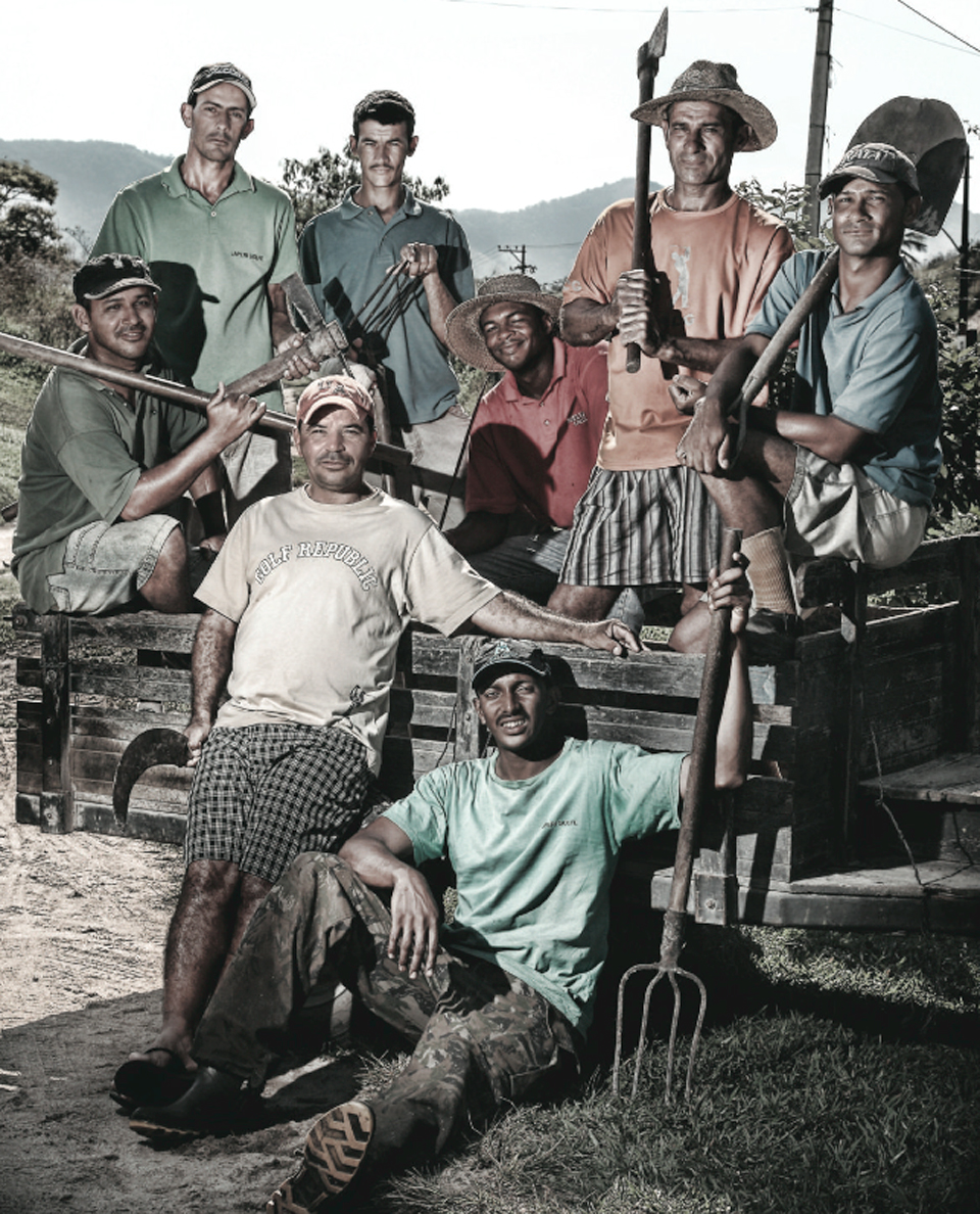The men who labored by hand to make Japeri a reality, led by Jair Medeiros (standing, front).