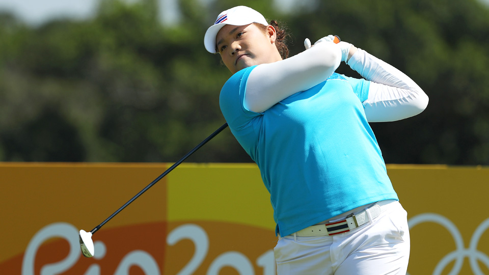 Ariya Jutanugarn tees off during the first day of the Olympic women's golf competition in Rio. Jutanugarn shot an opening-round 65 to take the lead.