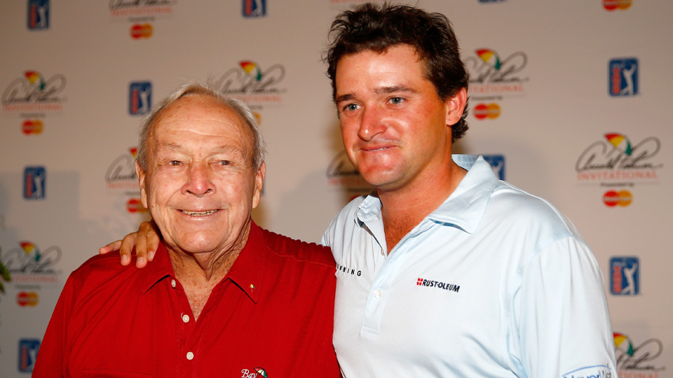 Golf legend Arnold Palmer stands with his grandson, Sam Saunders, before the Arnold Palmer Invitational in 2015.