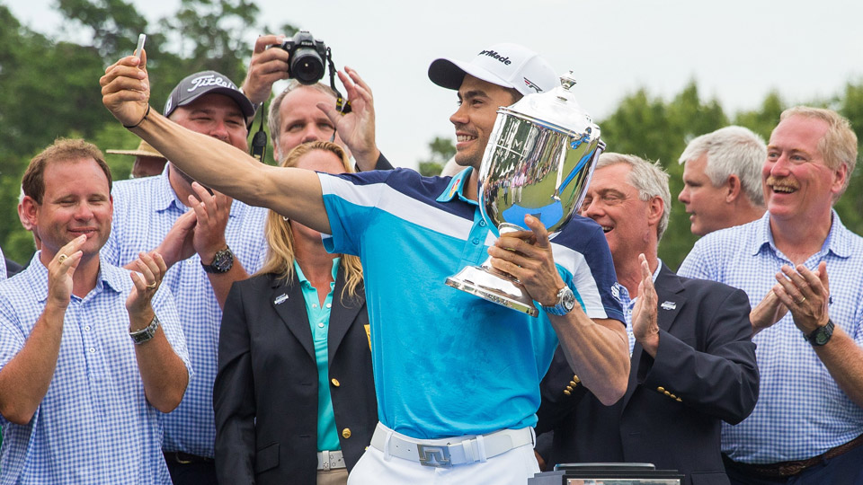 Camilo Villegas takes a selfie with the Sam Snead trophy after winning the Wyndham Championship at Sedgefield Country Club in Greensboro, NC.