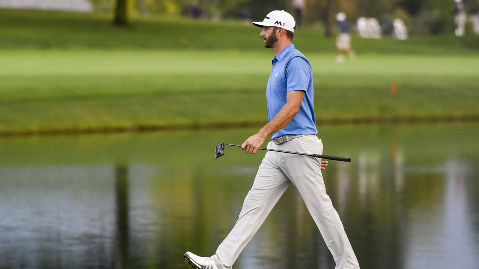 Dustin Johnson walks with his new TaylorMade Spider Limited putter on the 18th hole fairway during the first round of the BMW Championship at Crooked Stick Golf Club.