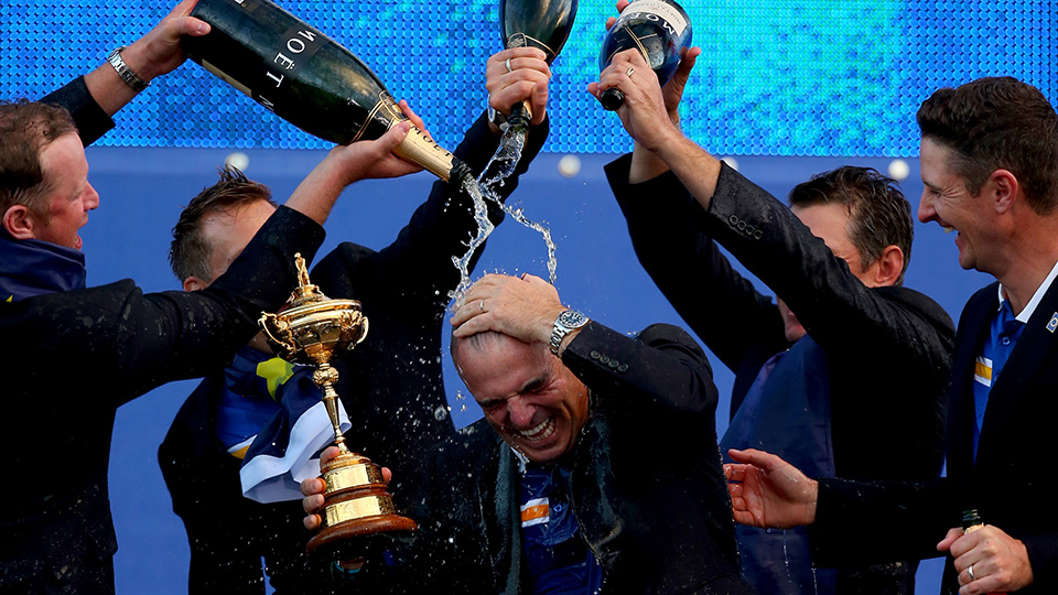 Europe team captain Paul McGinley receives a dousing from his team after winning the 2014 Ryder Cup at Gleneagles.
