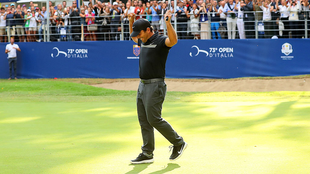 Francesco Molinari celebrates after holing his putt on the 18th hole to win the Italian Open at Golf Club Milano.