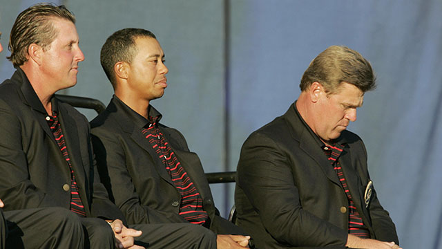 U.S. Ryder Cup captain Hal Sutton (R) and players Tiger Woods (C) and Phil Mickelson (L) look on during the closing ceremonies 19 September, 2004 at Oakland Hills Country Club.