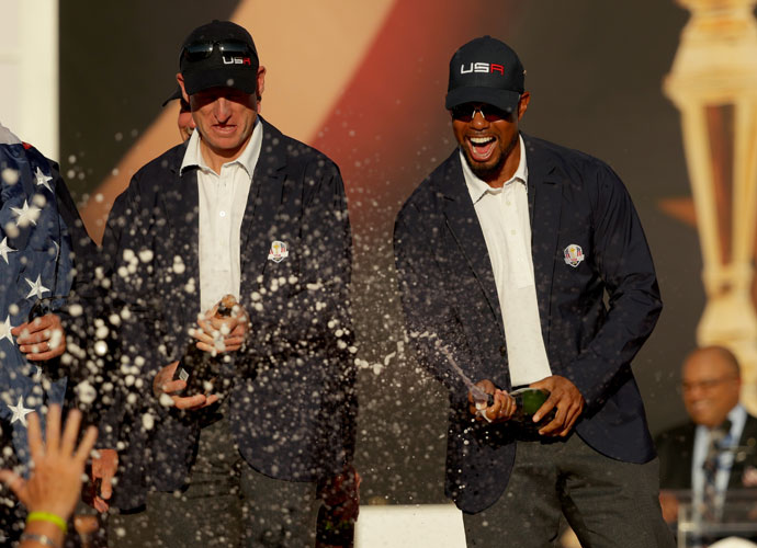Jim Furyk and Tiger Woods popped a few bottles of champagne following the victory.