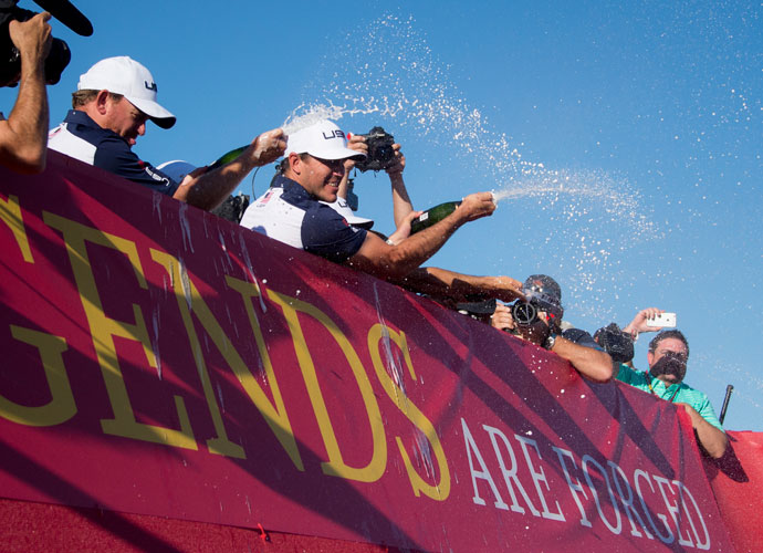 The players showered their fans in champagne from the balcony.