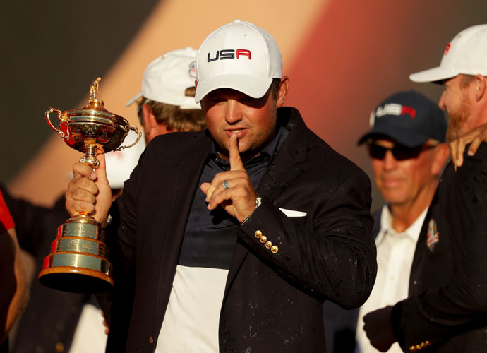 Patrick Reed, Ryder Cup in hand, flashes his signature move.