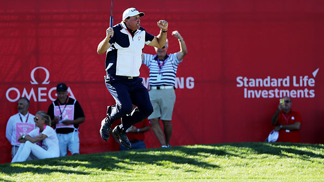 Phil Mickelson of the United States reacts after a putt on the 18th green during singles matches of the 2016 Ryder Cup at Hazeltine National Golf Club.