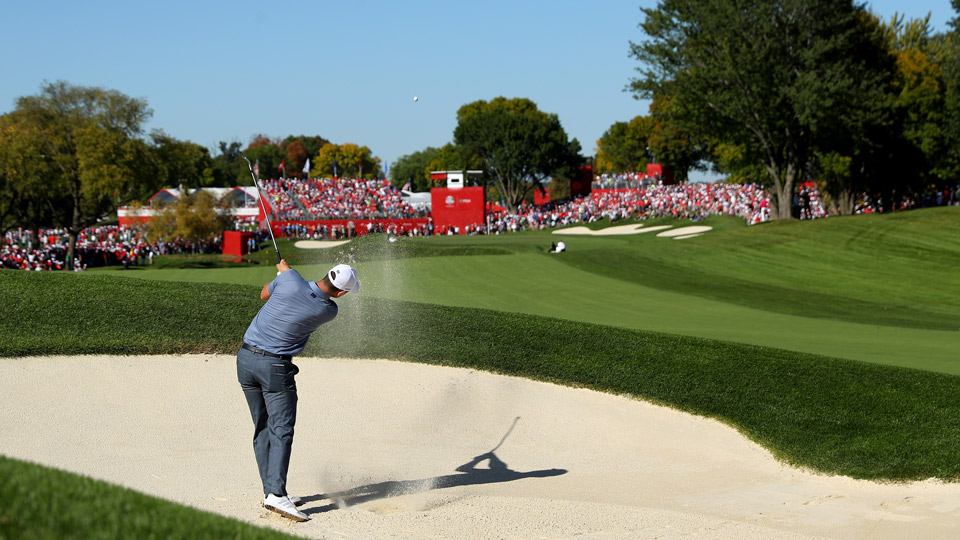 Justin Rose hits his approach shot on the 16th hole.