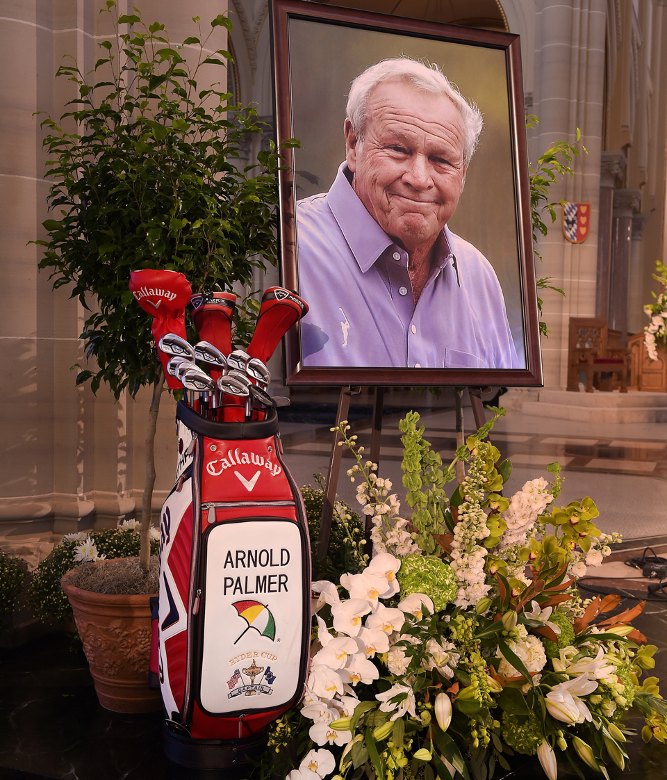 A portrait of Arnold Palmer and his golf bag sat at the front of the basilica.
