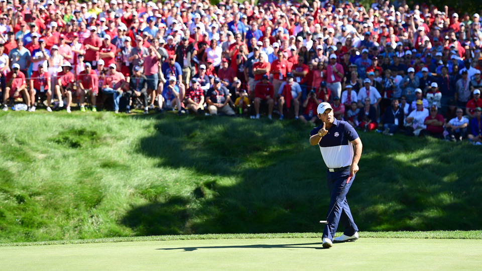 Patrick Reed waves his finger at Rory McIlroy after rolling in a birdie putt on the 8th hole on Sunday.