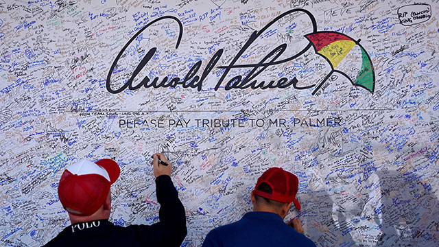 Fans sign a tribute wall for American golfer Arnold Palmer at Hazeltine National Golf Course ahead of the 41st Ryder Cup at Hazeltine National Golf Course in Chaska, Minnesota, September 29, 2016.