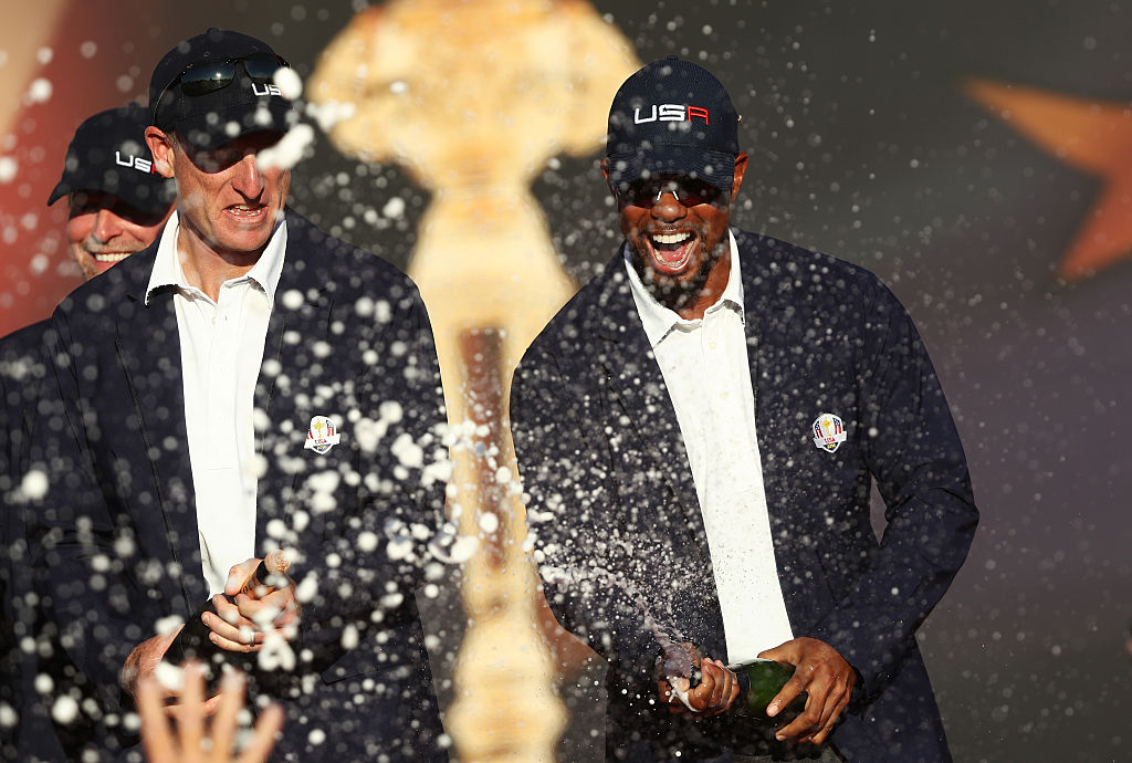 Jim Furyk and Tiger Woods celebrate during the closing ceremony of the 2016 Ryder Cup at Hazeltine.