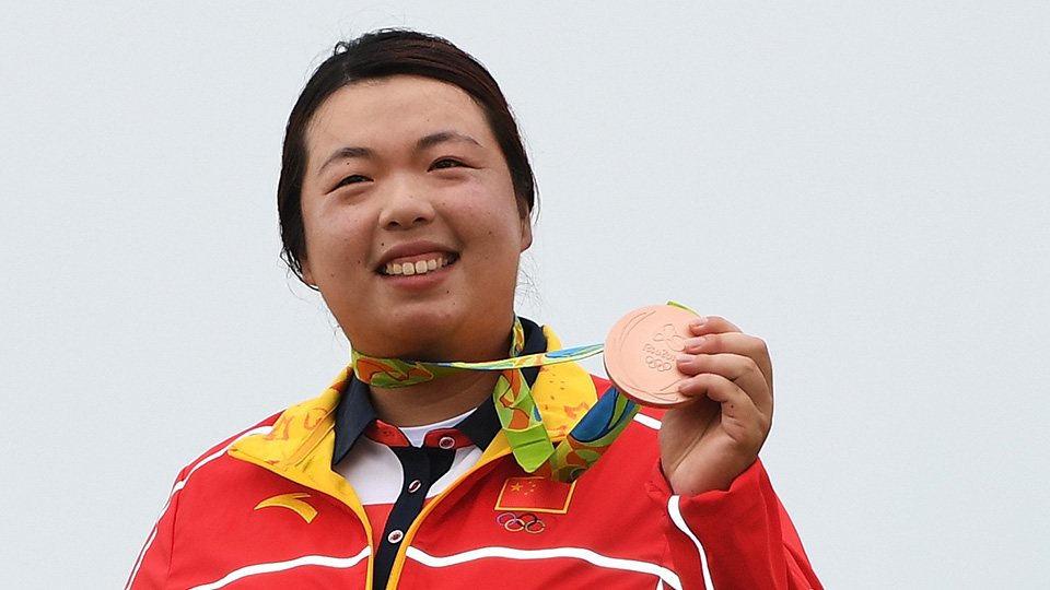 Bronze medalist Shanshan Feng of China poses on the podium during the medal ceremony for women's golf at the Rio 2016 Olympic Games.