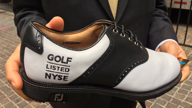 A commemorative Footjoy shoe from the first day of public trading for Acushnet.
