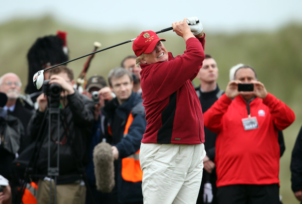 Donald Trump opens The Trump International Golf Links Course in Balmedie by hitting the first ball down the first fairway on July 10, 2012 in Balmedie, Scotland.