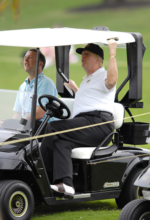 Donald Trump strains to watch the action during the first round of the ADT Championship at the Trump International Golf Club in West Palm Beach, Florida on Thursday, November 16, 2006.
