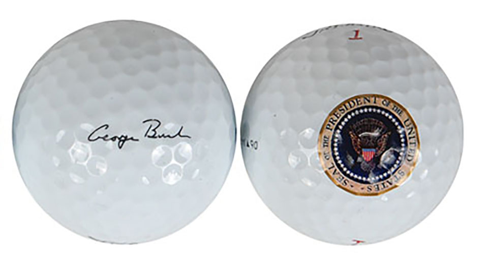 Bush's signed and sealed golf balls are up for grabs at RR Auction.