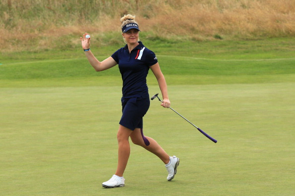 Charley Hull of England celebrates a birdie putt on the 18th green during the third round of the Ricoh Women's British Open.