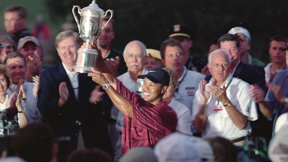 Woods hoists the U.S. Open Trophy after winning at Bethpage Black Golf Course.