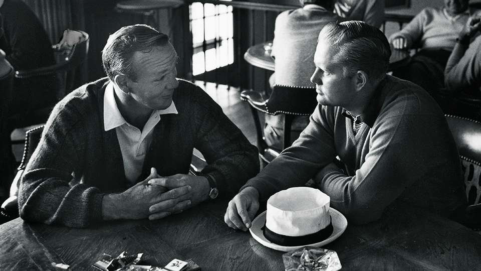 Arnold Palmer and Jack Nicklaus sitting at a table at Laurel Valley Country Club during the 1965 PGA Championship in Ligonier, Pa.