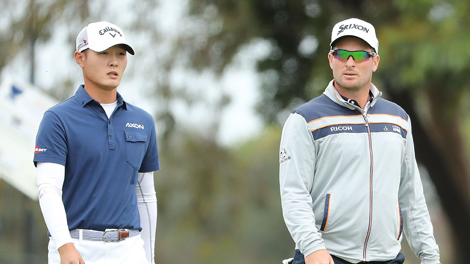 Danny Lee and Ryan Fox of New Zealand look on during day two of the 2016 World Cup of Golf at Kingston Heath Golf Club.