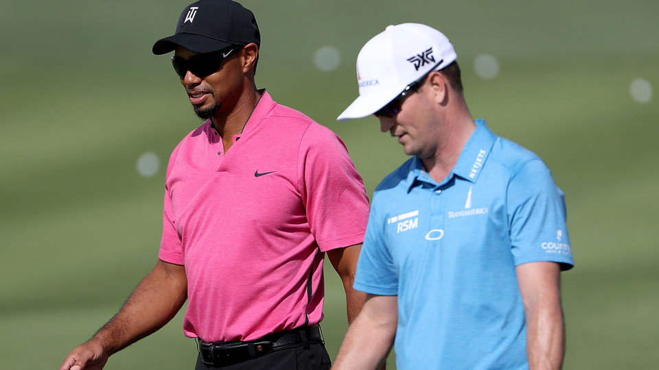 Tiger Woods walks with Zach Johnson at the Hero World Challenge.