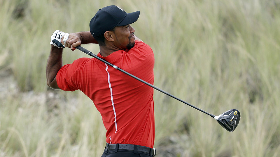 Tiger Woods watches his tee shot from the third hole during the final round at the Hero World Challenge.