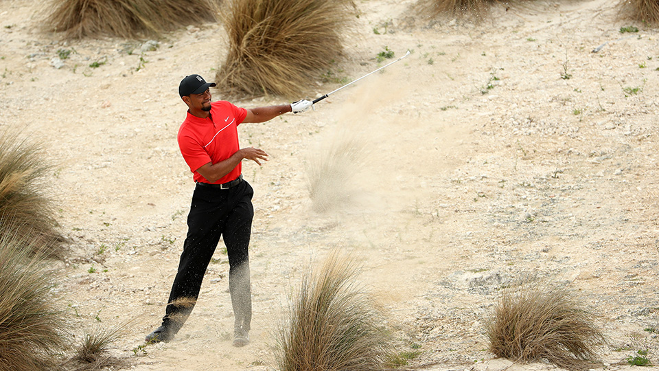 Tiger Woods hits his second shot on the third hole during the final round of the Hero World Challenge at Albany, The Bahamas.