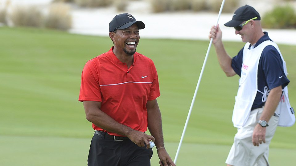 Tiger Woods reacts with surprise after making a birdie putt on the eighth hole.