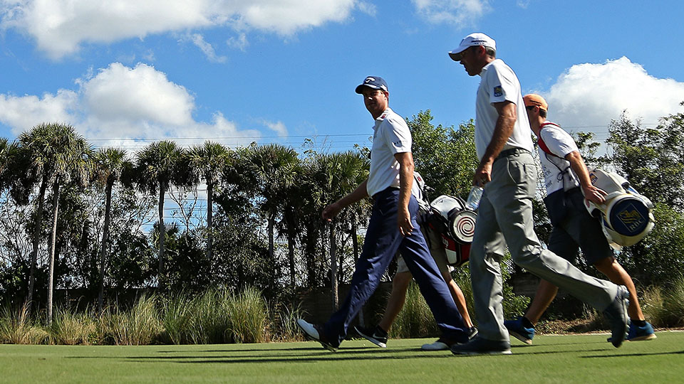 Playing partners Harris English and Matt Kuchar walk up to the second hole during the final round of the 2015 Franklin Templeton Shootout.