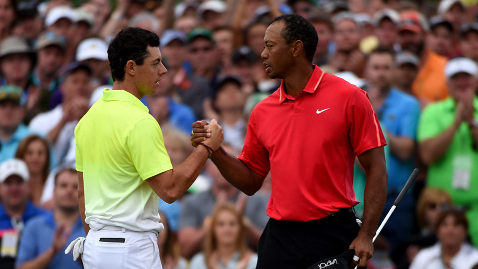 Rory McIlroy and Tiger Woods shake hands on the 18th green during the final round of the 2015 Masters.