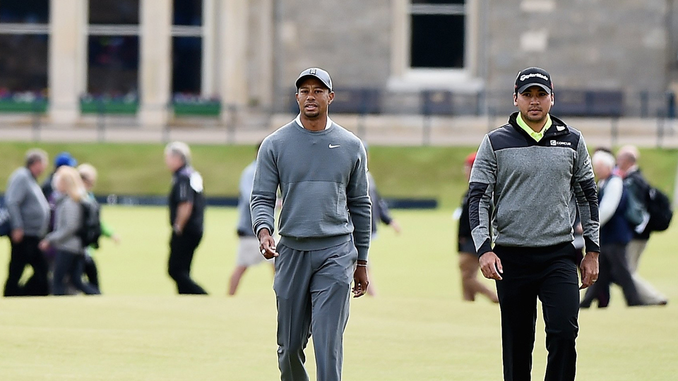 Tiger Woods and Jason Day walk up the fairway at St. Andrews during the 2015 British Open.