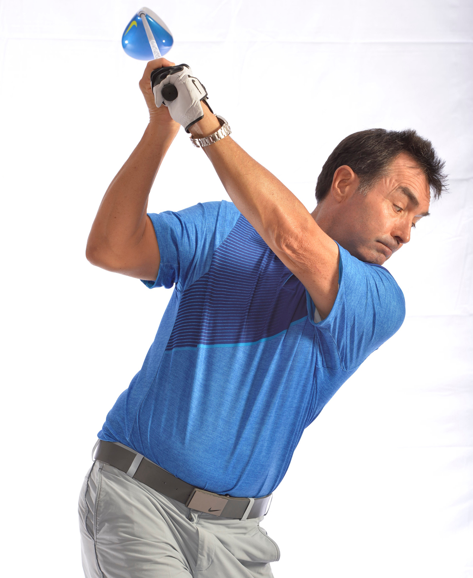 Pull your right shoulder behind you on the way to the top. This fuels a smoother, fuller backswing.