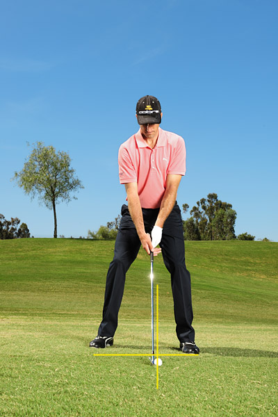 "BEFORE YOUR NEXT IRON...                                              Set Up for Ball-First Contact                                              If I'm not hitting great iron shots, I'll set up with my feet closer together, choke down on the grip, and play the ball back in my stance. These adjustments help me contact the ball before the club hits the turf and hit more of a knockdown-type shot. You'll see a lot of guys do this on Sundays when they're in the hunt. They're looking for a ""safe"" feeling.                       Normal setup"
