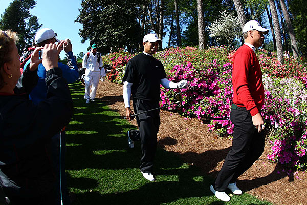 "Practice Rounds and Preparations at Augusta                       On Wednesday morning, Tiger Woods showed up for a practice round with Robert Karlsson (left) and Bubba Watson (not pictured).                                                                      function fbs_click() {u=""http://www.golf.com/golf/gallery/article/0,28242,1889652,00.html"";t=document.title;window.open('http://www.facebook.com/sharer.php?u='+encodeURIComponent(u)+'&t='+encodeURIComponent(t),'sharer','toolbar=0,status=0,width=626,height=436');return false;} html .fb_share_link { padding:2px 0 0 20px; height:16px; background:url(http://b.static.ak.fbcdn.net/images/share/facebook_share_icon.gif?8:26981) no-repeat top left; }Share on Facebook                                                                                            addthis_pub             = 'golf';                        addthis_logo            = 'http://s9.addthis.com/custom/golf/golf_logo.jpg';                       var addthis_offset_top = -155;                       addthis_logo_color      = '555555';                       addthis_brand           = 'Golf.com';                       addthis_options         = 'email, facebook, twitter, digg, delicious, myspace, google, reddit, live, more'                                                                      Share"