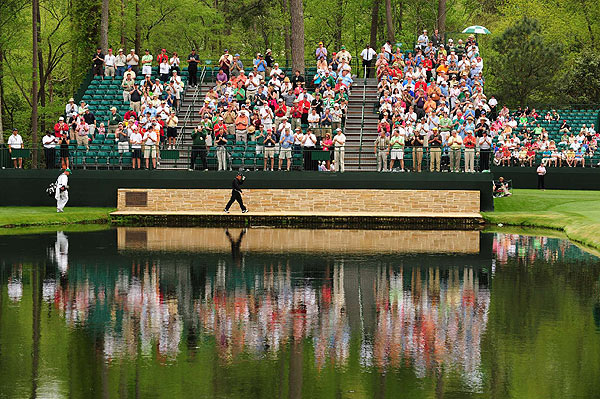 Gary Player acknowledged the crowd as he crossed the Sarazen bridge at the 15th hole, in what would be his last round at the Masters.
