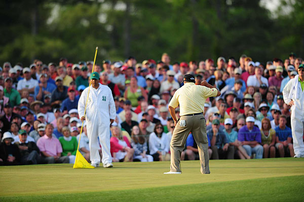 After Perry settled for a bogey, Cabrera knocked in a par putt for his first green jacket.