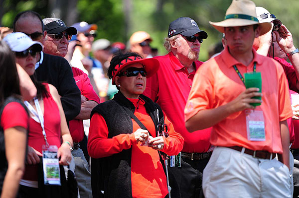 Kultida Woods, Tiger's mother, followed her son's round with an entourage dressed in red.