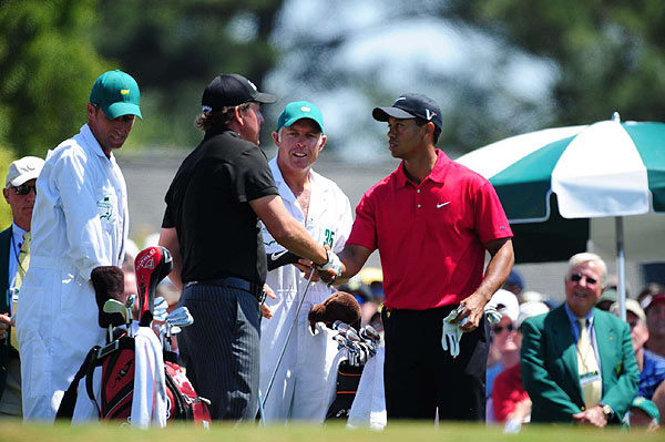 Tiger Woods and Phil Mickelson exchanged a firm handshake on the first tee Sunday. They were not in the last group, but they were still the main attraction for many fans.