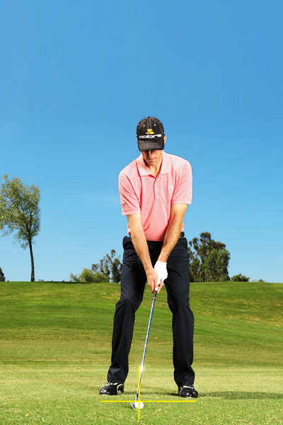 On a bad-iron day, move the ball back and narrow your stance to ensure ball-first contact.