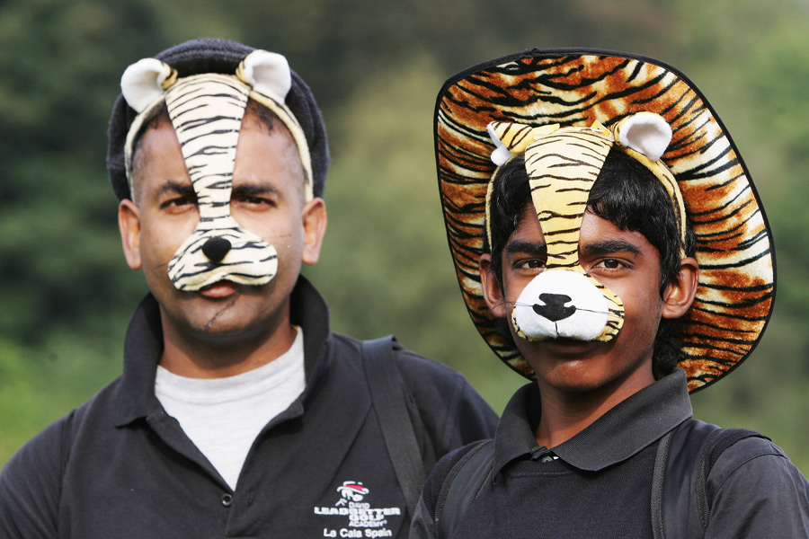 These fans opted for masks at the 2006 American Express in England.
