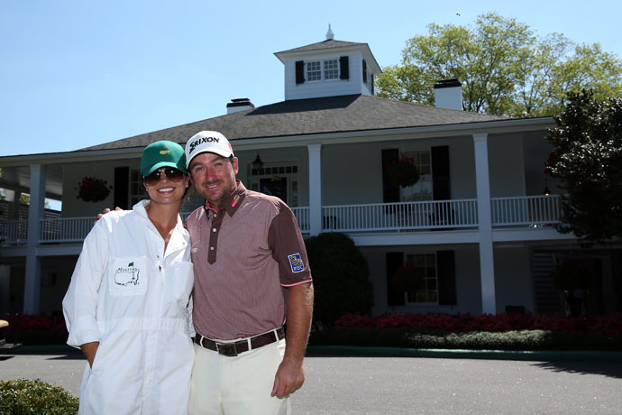 Graeme McDowell poses with his then-fiance, Kristin Stape, during the Par 3 Contest prior to the start of the 2013 Masters Tournament at Augusta National Golf Club.