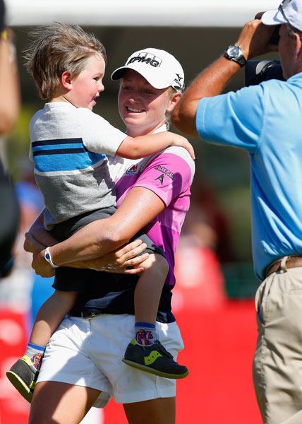 Lewis celebrated with nephew Cole Wysocki after winning the 2014 North Texas LPGA Shootout at the Las Colinas Country Club in Irving. She shot 71-64-69-64 for a six-stroke advantage over Meena Lee and seven ahead of Michelle Wie. The victory was her first of three during this season.