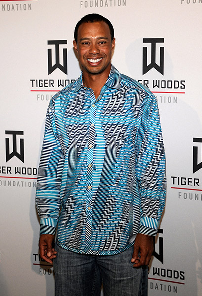 Tiger Woods appears at Tiger Jam 2012. The bands at Tiger Jam might chance but his dress code has remained the same.