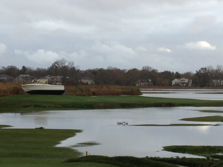 A boat was washed onto the fairway at No. 15.