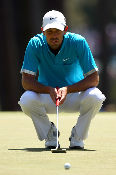 BEST: CHARL SCHWARTZEL                     It's been a slow start to the week (sartorially speaking, of course) for Schwartzel, but Saturday's outfit was a definite winner. I love the color of his shirt and the plaid contrast lining on his sleeves is super cool.