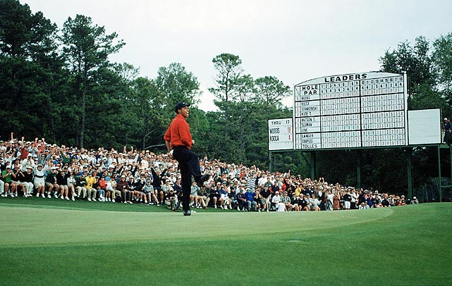 Woods threw his signature fist pump after sinking the winning putt for his first major in 1997.