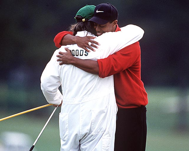 """Woods embraced his caddie Mike """"Fluff"""" Cowan after the final putt dropped."""