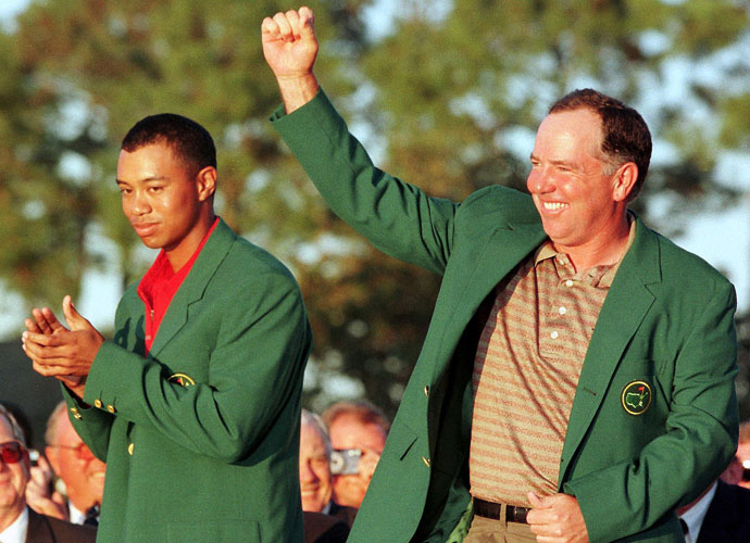 O'Meara slipped into his green jacket with some help from from 1997 champion Tiger Woods.